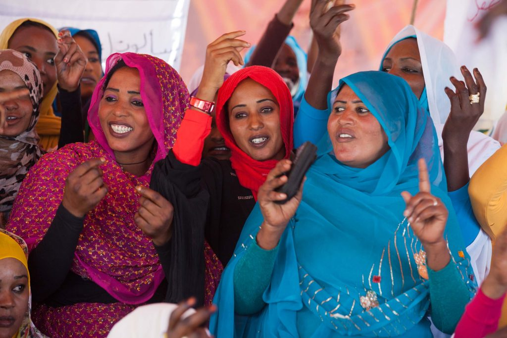 14 March 2013. Al Koma: Women dance traditional songs performed by a local singer in Al Koma village, North Darfur. Nearly 500 men and women in Al Koma village, some 80 kilometers west of El Fasher, celebrated International Women's Day in an event facilitated by UNAMID's Gender Advisory Unit and the Government of Sudan. Women leaders from North Darfur attended the event, which featured traditional nomadic songs and dances.<br /> Photo by Albert González Farran, UNAMID.